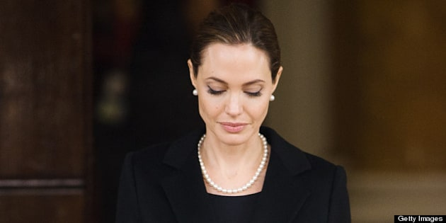 US actress and humanitarian campaigner Angelina Jolie leaves Lancaster House in central London on April 11, 2013 after speaking during an announcement of funding to address conflict sexual violence on the sidelines of the G8 Foreign Ministers meeting. British Foreign Secretary William Hague and Angelina Jolie spoke at the G8 Foreign Minister?s meeting to announce 10 million GBP (15,340,000 USD) funding to support efforts to tackle sexual violence in conflict and violence against women and girls (VAWG). AFP PHOTO / LEON NEAL        (Photo credit should read LEON NEAL/AFP/Getty Images)