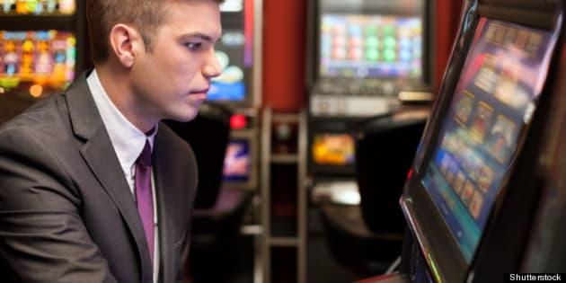 young handsome men gambling in...