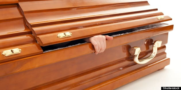 brown coffin with hand  on the...