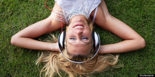 smiling woman in headphones on...