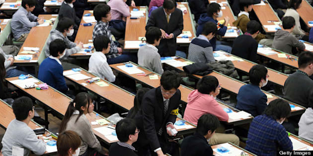 NAGOYA, JAPAN - JANUARY 19:  (CHINA OUT, SOUTH KOREA OUT) High school students attend the National Center Test at Nagoya University on January 19, 2013 in Nagoya, Aichi, Japan. 573,344 who wish to enter universities and colleges applied for the test.  (Photo by The Asahi Shimbun via Getty Images)