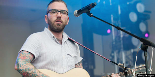 CHICAGO, IL - AUGUST 07: Dallas Green of City And Colour performs on stage during Lollapalooza Festival 2011 at Grant Park on August 7, 2011 in Chicago, United States. (Photo by Daniel Boczarski/Redferns)