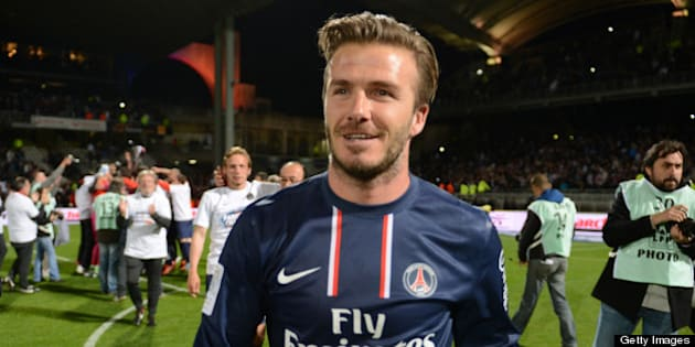 (FILES) Picture taken on May 12, 2013 shows PSG midfielder David Beckham celebrating after Paris Saint-Germain won the French L1 title at the Gerland stadium in Lyon. David Beckham is to retire from professional football at the end of the season, his representative announced on May 16, 2013.   AFP PHOTO/PHILIPPE DESMAZES        (Photo credit should read PHILIPPE DESMAZES/AFP/Getty Images)