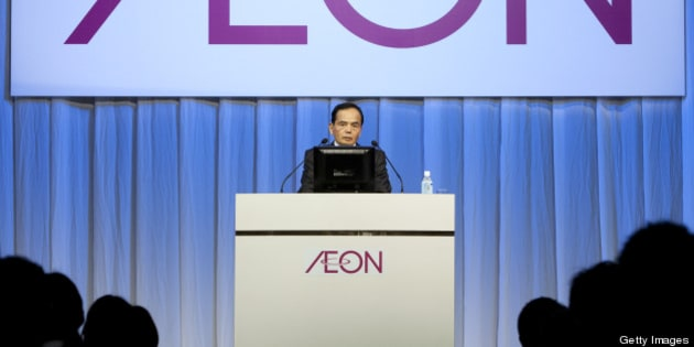 Motoya Okada, president and chief executive officer of Aeon Co., speaks during an induction ceremony for the company's new hires in Chiba City, Japan, on Sunday, April 1, 2012. Aeon Co. is Japan's largest supermarket operator. Photographer: Tomohiro Ohsumi/Bloomberg via Getty Images