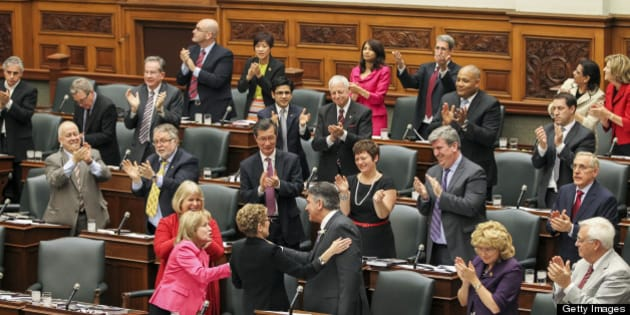 TORONTO, ON - MAY 2: Finance Minister Charles Sousa is congratulated by Ontario Premier Kathleen Wynne with and the Liberal members after tabling $127.6-billion budget spending plan Thursday.        (Andrew Francis Wallace/Toronto Star via Getty Images)