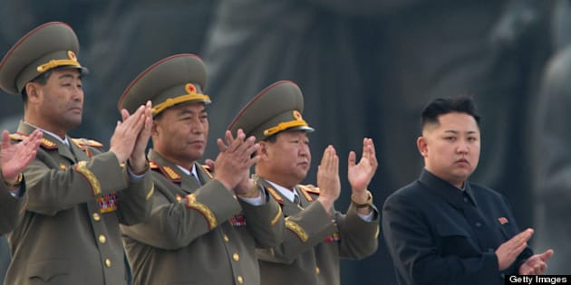 North Korean leader Kim Jong-Un (R) claps during the unveiling ceremony of two statues of former leaders Kim Il-Sung and Kim Jong-Il in Pyongyang on April 13, 2012.  North Korea's new leader Kim Jong-Un on April 13 led a mass rally for his late father and grandfather following the country's failed rocket launch. AFP PHOTO / Ed Jones        (Photo credit should read Ed Jones/AFP/Getty Images)