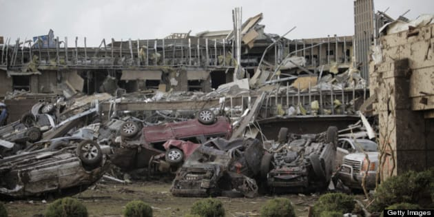 MOORE, OK- MAY 20:   Flipped vehicles are piled up outside the heavily damaged Moore Medical Center after a powerful tornado ripped through the area on May 20, 2013 in Moore, Oklahoma. The tornado, reported to be at least EF4 strength and two miles wide, touched down in the Oklahoma City area on Monday killing at least 51 people. (Photo by Brett Deering/Getty Images)