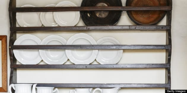 Kitchen Shelves. Old spice cupboard loaded with dishes.