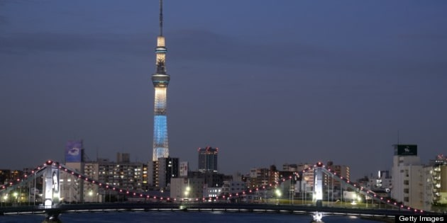 View of Tokyo skyline with tower and bridge.