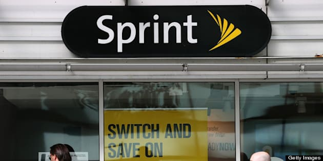 SAN FRANCISCO, CA - APRIL 15:  Pedestrians walk by a Sprint store on April 15, 2013 in San Francisco, California.  Dish Network Corp has offered to purchase Sprint Nextel Corp for $25.5 billion in cash and stock.  (Photo by Justin Sullivan/Getty Images)