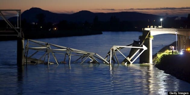 MT. VERNON, WASHINGTON  - MAY 23: Crews survey the scene of a bridge collapse on Interstate 5 on May 23, 2013 near Mt. Vernon, Washington. I-5 connects Seattle, Washington to Vancouver B.C., Canada. No deaths have been reported, and three people were taken to hospitals with injuries. (Stephen Brashear/Getty Images)