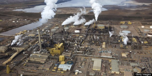 A large oil refinery along the Athabasca River in Alberta's Oilsands.  Fort McMurray, Alberta.