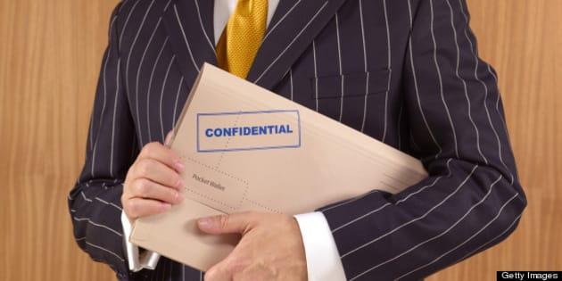 Politician with confidential file folder