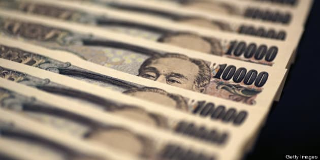Japanese 10,000 yen banknotes are arranged for a photograph in Tokyo, Japan, on Monday, Feb. 25, 2013. The yen's protracted climb against the dollar over the past four decades is over, said Makoto Utsumi, a former top Japanese currency official. Photographer: Yuriko Nakao/Bloomberg via Getty Images
