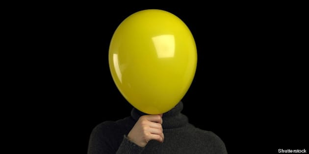 a yellow balloon over a persons ...