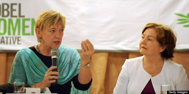 Nobel Peace Laureates Jody Williams (L) from the US addresses a press conference as Mairead Maguire (R) from Northern Ireland looks on in New Delhi on October 29, 2009. Nobel peace laureates called for governments in the region to use the forthcoming elections in Myanmar to push the ruling military junta harder on democratic rights. AFP PHOTO/ Prakash SINGH (Photo credit should read PRAKASH SINGH/AFP/Getty Images)