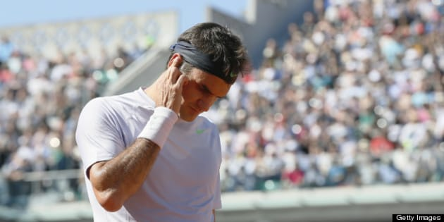 Switzerland's Roger Federer reacts after a point against France's Jo-Wilfried Tsonga during a French tennis Open quarter final match at the Roland Garros stadium in Paris on June 4, 2013. AFP PHOTO / KENZO TRIBOUILLARD        (Photo credit should read KENZO TRIBOUILLARD/AFP/Getty Images)