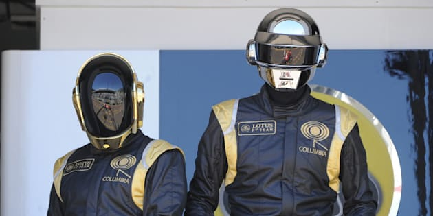 French Daft Punk band members pose in the pits at the Monaco Formula One Grand Prix at the Circuit de Monaco in Monte Carlo on May 26, 2013.  AFP PHOTO / BORIS HORVAT        (Photo credit should read BORIS HORVAT/AFP/Getty Images)