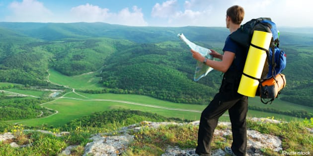 man tourist in mountain read...