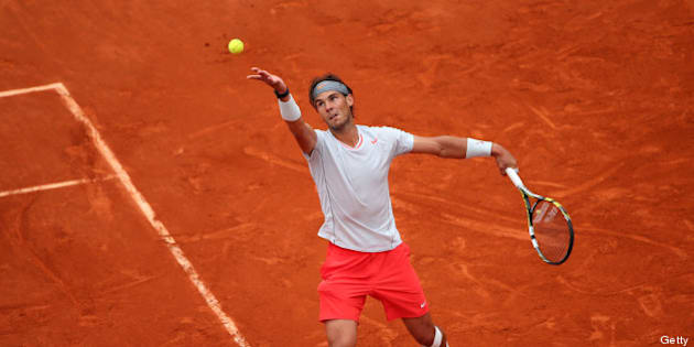 PARIS, FRANCE - JUNE 09:  Rafael Nadal of Spain serves during the Men's Singles final match against David Ferrer of Spain on day fifteen of the French Open at Roland Garros on June 9, 2013 in Paris, France.  (Photo by Julian Finney/Getty Images)