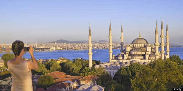 Also known as the Sultan Ahmet Mosque; the Bosphorus is visible beyond.
