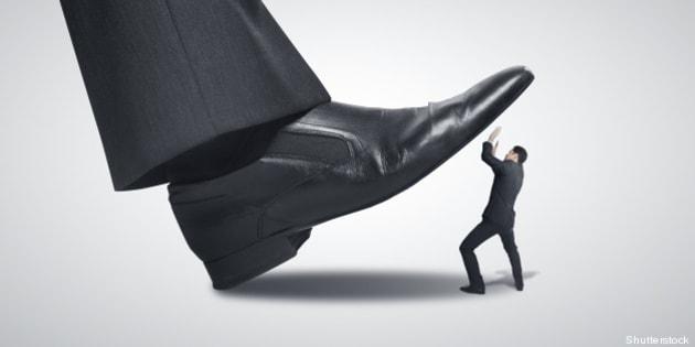 big foot stepping on businessman
