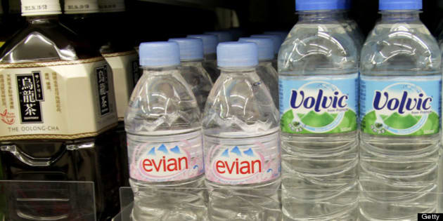 Bottles of Evian and Volvic water produced by Danone are displayed next to bottles of Suntory Holdings Ltd. tea at a convenience store in Tokyo, Japan, on Tuesday, Oct. 18, 2011. Danone, the owner of the Evian and Volvic bottled-water brands, is in talks to sell water assets to Japan's Suntory Holdings Ltd., said three people familiar with the matter. Photographer: Koichi Kamoshida/Bloomberg via Getty Images