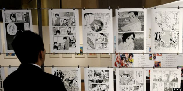 A visitors walks in the time tunnel exhibit of the 'Milano Manga Festival' on May 2, 2013 during the press preview in Milan. The exhibition, tracing the 200-year history of Japanese manga will run from May 3 to July 21. AFP PHOTO / OLIVIER MORIN        (Photo credit should read OLIVIER MORIN/AFP/Getty Images)