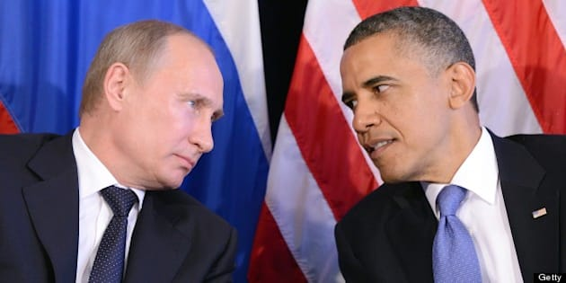 US President Barack Obama (R) listens to Russian President Vladimir Putin after their bilateral meeting in Los Cabos, Mexico on June 18, 2012 on the sidelines of the G20 summit. Obama and President Vladimir Putin met Monday, for the first time since the Russian leader's return to the presidency, for talks overshadowed by a row over Syria. The closely watched meeting opened half-an-hour late on the sidelines of the G20 summit of developed and developing nations, as the US leader sought to preserve his 'reset' of ties with Moscow despite building disagreements. AFP PHOTO/Jewel Samad        (Photo credit should read JEWEL SAMAD/AFP/GettyImages)