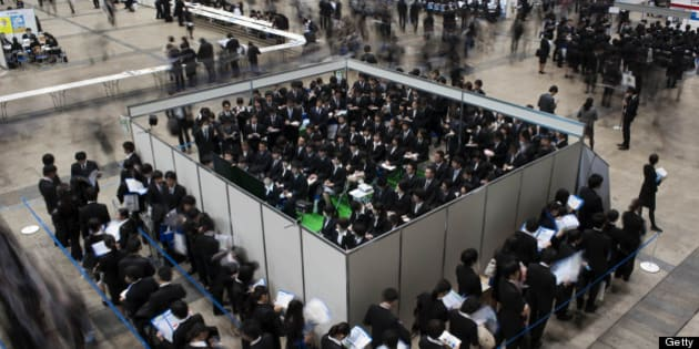 University students attend a job fair hosted by Recruit Co. at Makuhari Messe in Chiba City, Japan, on Sunday, Dec. 11, 2011. Japan's economy grew less than the government's initial estimate last quarter as companies reduced investment on concern overseas demand was stalling. Photographer: Akio Kon/Bloomberg via Getty Images