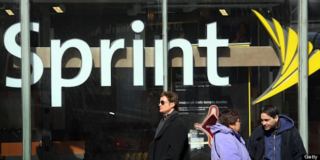 CHICAGO - FEBRUARY 28:  The Sprint Nextel logo hangs in the window of a Sprint retail store February 28, 2008 in Chicago Illinois. Sprint said it lost $29.5 billion during the quarter ending Dec. 31.  (Photo by Scott Olson/Getty Images)