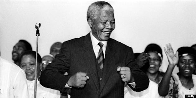 JOHANNESBURG, SOUTH AFRICA: (SOUTH AFRICA OUT) Nelson Mandela smiles as he attends an ANC victory march in 1994 in Johannesburg, South Africa.  (Photo by  Paul Weinberg/Gallo Images/Getty Images)