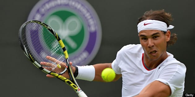 Spain's Rafael Nadal returns against Belgium's Steve Darcis during their men's first round match on day one of the 2013 Wimbledon Championships tennis tournament at the All England Club in Wimbledon, southwest London, on June 24, 2013. AFP PHOTO / BEN STANSALL -  RESTRICTED TO EDITORIAL USE        (Photo credit should read BEN STANSALL/AFP/Getty Images)