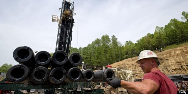 Brian Lairson prepares drill pipe as a shale-gas well is drilled in Mannington, West Virginia, U.S., on Friday, April 30, 2010. This well was being drilled into the Marcellus Shale, a formation that may hold 262 trillion cubic feet of recoverable natural gas, making it the largest known deposit according to a U.S. Energy Department estimate. Photographer: Ty Wright/Bloomberg via Getty Images