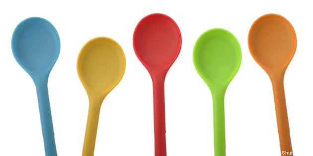 five colorful ladles isolated...