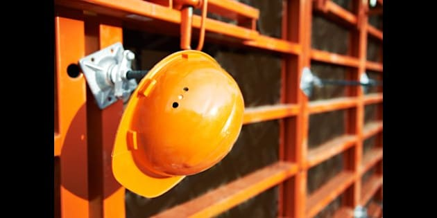 construction hardhat over wall...