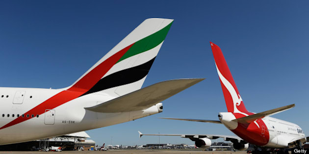 Airbus SAS A380-800 aircraft operated by Emirates Airline, left, and Qantas Airways Ltd. stand on the tarmac during a media event in Sydney, Australia, on Thursday, Sept. 6, 2012. Qantas formed an alliance with Emirates to coordinate prices and schedules, while scrapping a similar deal with British Airways, as the carrier tries to reverse losses on long-haul routes. Photographer: Brendon Thorne/Bloomberg via Getty Images