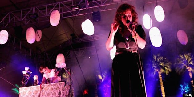 INDIO, CA - APRIL 12:  Singer Megan James of Purity Ring performs onstage during day 1 of the 2013 Coachella Valley Music & Arts Festival at the Empire Polo Club on April 12, 2013 in Indio, California.  (Photo by Karl Walter/Getty Images for Coachella)