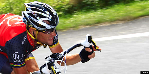 US Lance Armstrong speeds in a descent during the 199,5 km and 16th stage of the 2010 Tour de France cycling race run between Bagneres-de-Luchon and Pau, Southwestern France,  on July 20, 2010.  AFP PHOTO / JOEL SAGET (Photo credit should read JOEL SAGET/AFP/Getty Images)