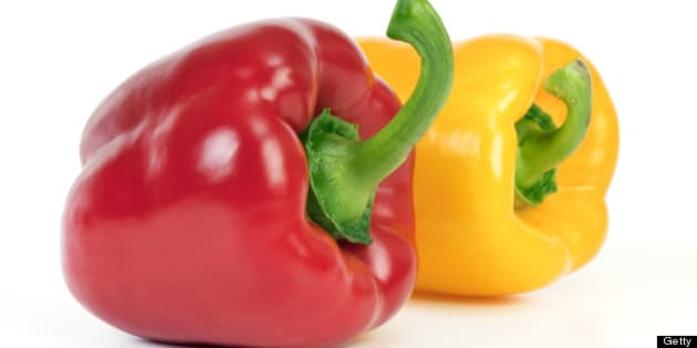 Yellow and red bell pepper  isolated on white background.