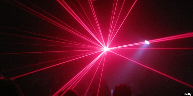 people clubbing with laser lights