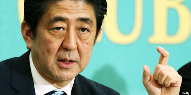 Shinzo Abe, Japan's prime minister and president of the Liberal Democratic Party (LDP), gestures as he speaks during a debate at the Japan National Press Club in Tokyo, Japan, on Wednesday, July 3, 2013. Abe called for laws, not force-based order, in the Asia region during a televised debate with leaders of other political parties in Tokyo today ahead of the July 21 upper house election. Photographer: Haruyoshi Yamaguchi/Bloomberg via Getty Images