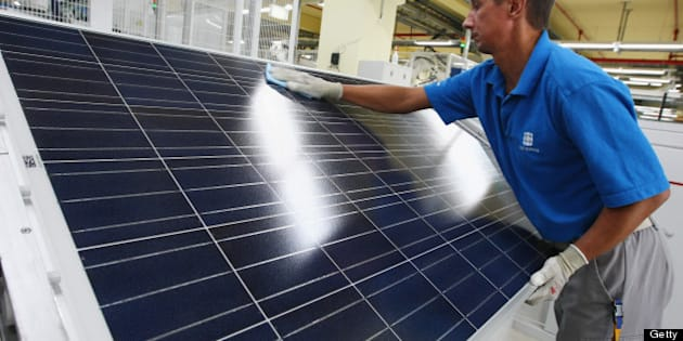 FRANKFURT (ODER), GERMANY - AUGUST 19:  A worker cleans a finished solar energy panel at a production plant of German solar panels maker Conergy on August 19, 2009 in Frankfurt (Oder), Germany. Conergy is expanding its production capacity in order to meet increasing worldwide demand for solar energy.  (Photo by Sean Gallup/Getty Images)