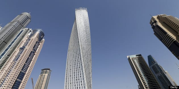 The Cayan tower (C), the world's tallest twisted tower stands at Dubai's Marina on June 11, 2013 in the United Arab Emirates, UAE.  AFP PHOTO/KARIM SAHIB        (Photo credit should read KARIM SAHIB/AFP/Getty Images)