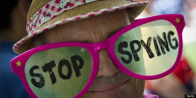 A human rights activists wears pink glasses reading 'stop spying' during a protest against the alleged violation of privacy by the US National Security Agency at McPherson square in downtown Washington DC, July 04, 2013. The recent leaking of  classified intelligence documents has led to revelations that the US is systematically seizing vast amounts of phone and web data.  AFP PHOTO / MLADEN ANTONOV        (Photo credit should read MLADEN ANTONOV/AFP/Getty Images)