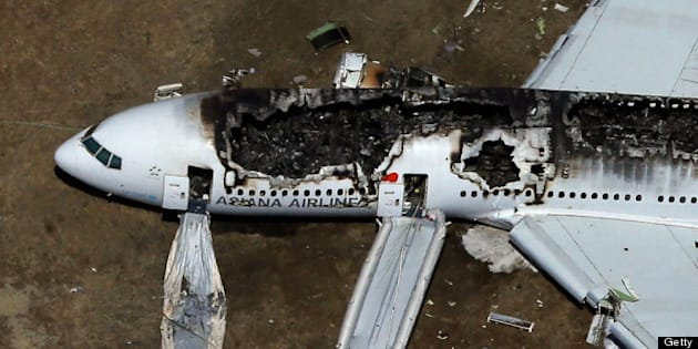 SAN FRANCISCO, CA - JULY 06:  A Boeing 777 airplane lies burned on the runway after it crash landed at San Francisco International Airport July 6, 2013 in San Francisco, California. An Asiana Airlines passenger aircraft coming from Seoul, South Korea crashed while landing. There has been at least two casualties reported. (Photo by Ezra Shaw/Getty Images)