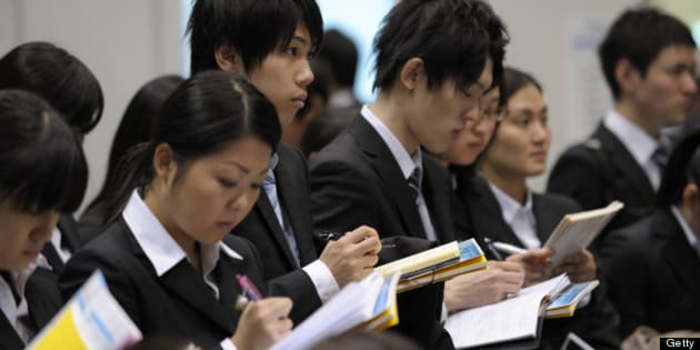 University students attend a job fair hosted by Mynavi Corp. in Tokyo, Japan, on Saturday, Dec. 8, 2012. In Japan, many students accept job offers from large companies six months before graduating and may stay with the same employer until retirement, said Yoshihide Suzuki, an administrative director at the career center at Waseda University. Photographer: Akio Kon/Bloomberg via Getty Images