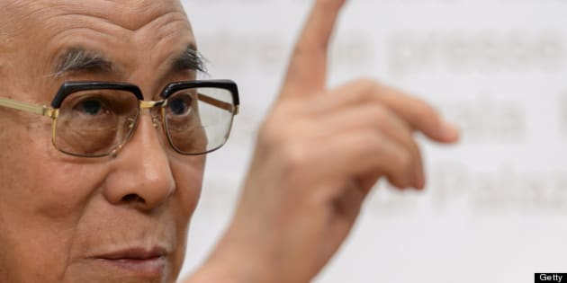 The Dalai Lama gestures during a press conference after visiting the Swiss House of Parliament on April 16, 2013 in Bern. The Dalai Lama will conclude his six days visit to Switzerland on April 17 with a visit to the Tibetan Institute Rikon, near Zurich. AFP PHOTO / FABRICE COFFRINI        (Photo credit should read FABRICE COFFRINI/AFP/Getty Images)