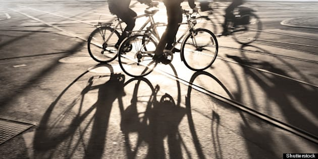silhouette of cyclists at...