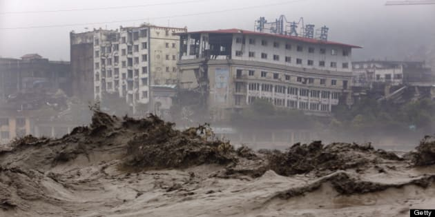 This picture taken on July 9, 2013 shows heavy flood waters sweeping through Beichuan in southwest China's Sichuan province. Rainstorms sweeping across parts of China have affected millions, causing landslides and disabling transportation in provinces such as Sichuan and Yunnan, state media reported. CHINA OUT     AFP PHOTO        (Photo credit should read AFP/AFP/Getty Images)